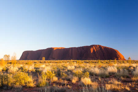 red mountain: Majestic Uluru at sunrise on a clear winters morning in the Northern Territory, Australia