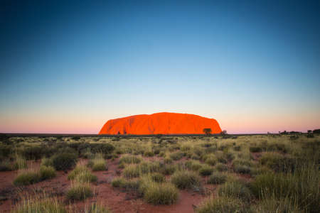 aus: Majestic Uluru at sunset on a clear winters evening in the Northern Territory, Australia