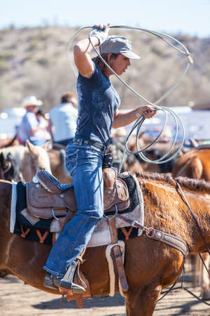arena rodeo: Wickenburg, USA - February 5, 2013: Riders compete in a team roping competition in Wickenburg, Arizona, USA