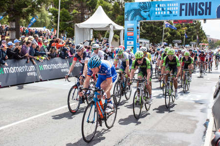 evans: MELBOURNE, AUSTRALIA - FEBRUARY 1: The peloton cross the finish line for the last lap in the Cadel Evans Great Ocean Road race Editorial