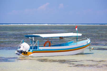sanur: A Balinese fishing boat moored on a Sanur beach in Bali, Indonesia