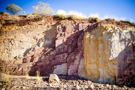 ochre: A sacred Aborginal site of Ochre Pits near Alice Springs in the Northern Territory, Australia Stock Photo