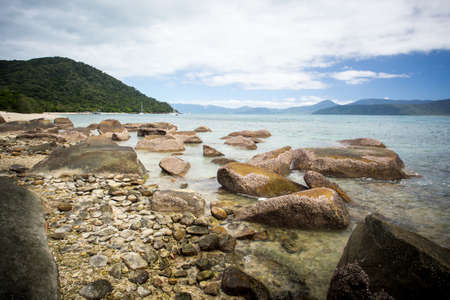 fitzroy: Fitzroy Island main beach area with rocks on a cool winters day in Queensland, Australia