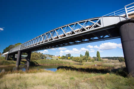 The iconic Dalgety Bridge built in 1888 serves as an important crossing over the Snowy River in New South Wales, Australia Stock Photo