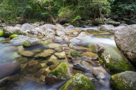 daintree: Water of the Mossman River flows over ancient rocks and boulders in Mossman Gorge, Queensland, Australia Stock Photo