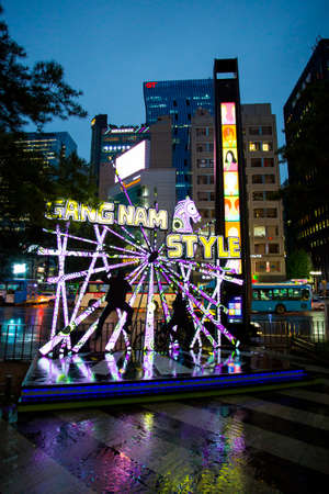 psy: Seoul, Republic of Korea - October 21, 2014: Located in the centre of the Gangnam District of Seoul, the Gangnam Style Horse Dancing Stage pays tribute to artist Psy Editorial