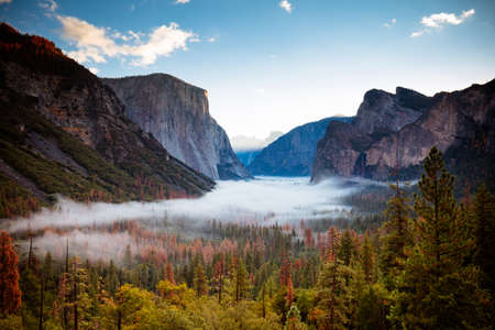 The iconic view of Yosemite Valley and the magnificent El Capitan at sunrise from Tunnel View in California, USA Stock Photo