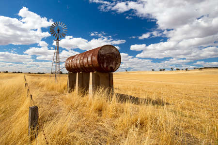 expanse: The vast expanse of farm fields in the Moolort Plains near the old townships of Maldon and Castlemaine in the goldfields region of Victoria, Australia