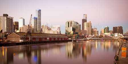 Melbourne skyline from South Wharf up the Yarra River at dusk in Melbourne, Victoria, Australia