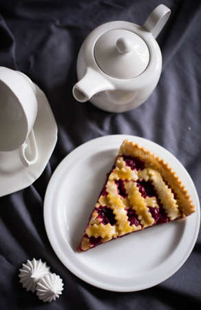 cherry pie: Big slice of cherry pie on a plate with teapot