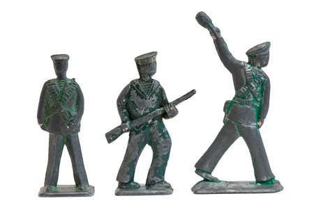 Viejos soldados de juguete de metal en forma de los marineros revolucionarios