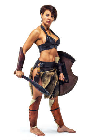 ancient warrior: Beautiful strong woman in the image of the warrior of the ancient world on white background Stock Photo