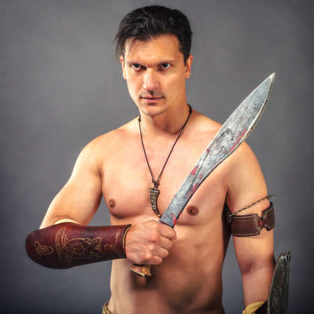 Muscular  man in the image of ancient warrior  barbarian.
