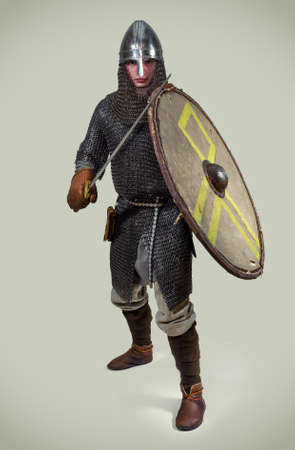 Young man in clothes and armour from the early middle ages. Stock Photo