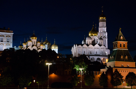Moscow, Russia. Ivan the Great bell tower behind the Kremlin wall. Night time