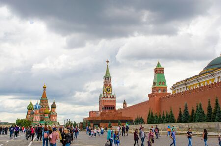 Moscow, Russia - July 15, 2017: Tourists walking on the Red Square near the Kremlin