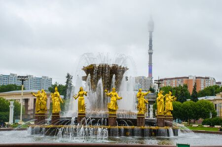 Moscow, Russia - July 15, 2017: Fountain of Friendship of Peoples at the Exhibition of Achievements of the National Economy in Moscow. Ostankino tower
