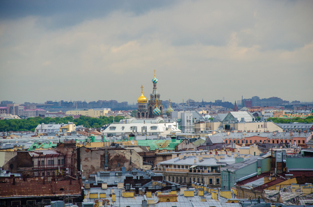 Domes of the Church of the Savior on Blood above the roofs of houses in St. Petersburg. Russia