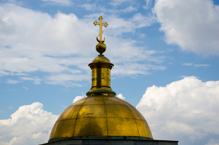 The dome on the colonnade of St. Isaacs Cathedral against the sky with clouds. Saint-Petersburg, Russia 写真素材