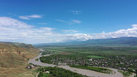 Aerial view on the Kura river and Caucasus mountains from Ancient cave city Uplistsikhe, Georgia