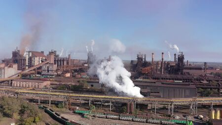 Blast furnaces aerial view. Metallurgical Plant. Environmental pollution.