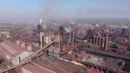Aerial view of blast furnaces. Smog in the city. 写真素材