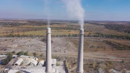 Aerial view. White smoke from the pipes of the lime factory.