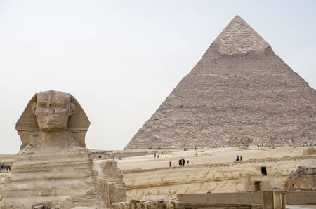 Great Sphinx on the background of the pyramid of Khafre. Cairo Egypt