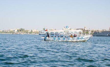 Luxor, Egypt - January 16, 2020 : Nile river near Luxor, Egypt. Motor boat on the Nile River in Egypt