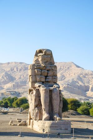 The Colossus of Memnon. Massive stone statue of the Pharaoh Amenhotep III in Luxor. Egypt