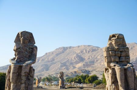 The Colossi of Memnon are two massive stone statues of the Pharaoh Amenhotep III in Luxor. Egypt