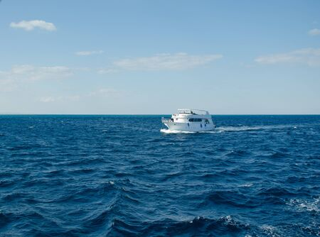 Red Sea Egypt. White motor yacht sailing on the sea.