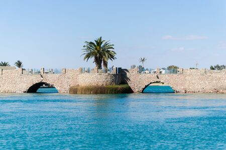 Bridge over the canal at El Gouna in Egypt. View from a boat sailing along the canals.