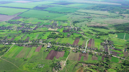 Aerial view of the settlement. Around spring agricultural fields