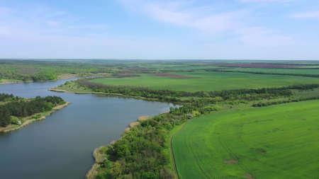Agricultural fields near the reservoir. Spring time aerial view