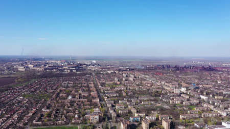 Aerial view. Metallurgical plant in the city center. Environmental pollution