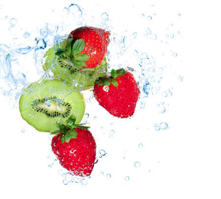 strawberries and kiwi water splash isolated on white photo