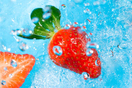 Strawberry splash in water, top view, bubbles with fruit reflection photo