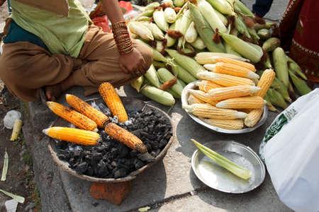 earn of corn roasted in the street of pokhara, Nepal photo