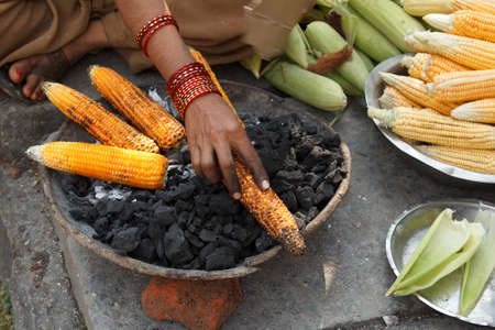 nack: earn of corn roasted in the street of pokhara, Nepal Stock Photo