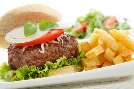 big burger with fries isolated on white photo