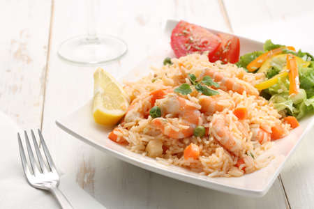 dish of seafood rice with salad photo