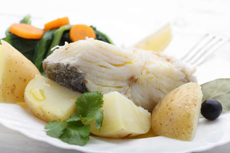 cod oil: boiled cod fish with potatoes and cole Stock Photo