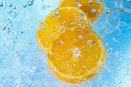 water splashing on orangei slices-top view photo