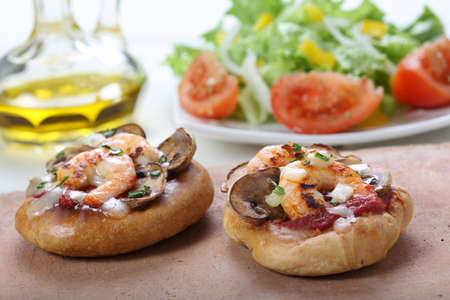 small shrimp pizza with salad photo
