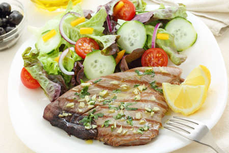 grilled tuna steak with garlic photo