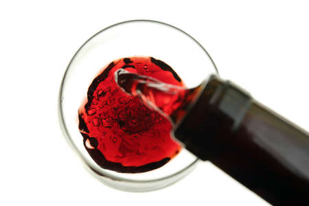 expensive food: red wine being poured into a glass isolated on white-blurry movement