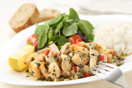 healthy dish of fried chicken and shrimps with watercress and white rice  photo
