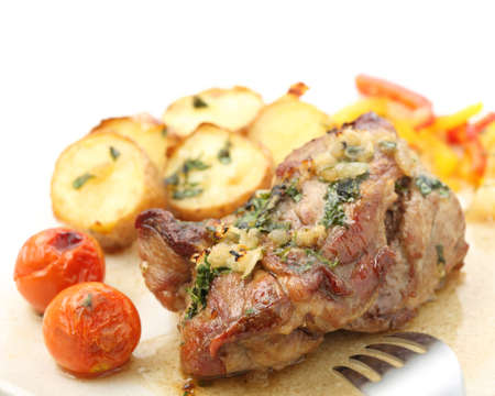 roasted pork with potatoes isolated on white  top  photo