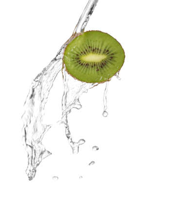 water being poured in a slice of kiwi  isolated on white photo